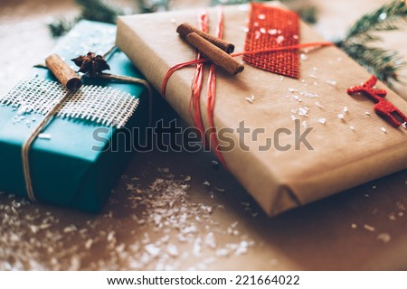 Modern Christmas gifts box presents on brown paper - stock photo
