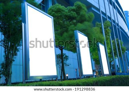 Modern city advertising light of tv boxes - stock photo