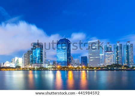 modern city at night, Benchakitti Park in Bangkok modern city at night - stock photo