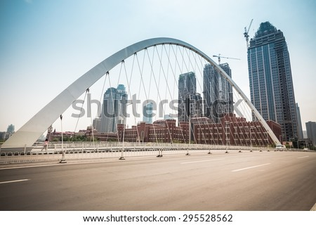 modern city bridge in tianjin , pavement and construction background - stock photo