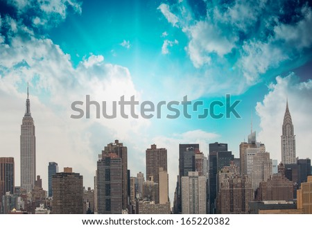 Modern city buildings and skyscrapers. Metropolis skyline with blue sky. - stock photo