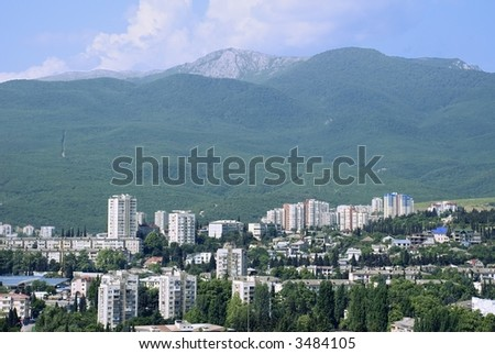 Modern city located in an environment of mountains. (Alushta - the Crimean mountains)