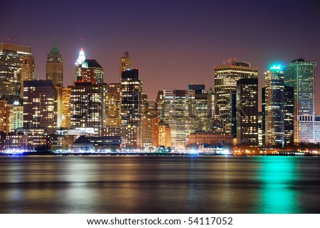 Modern City night scene, New York City Manhattan skyline at night - stock photo