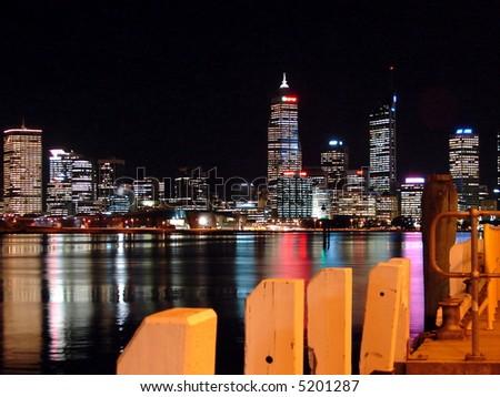 Modern city night scene, view from waterfront - stock photo