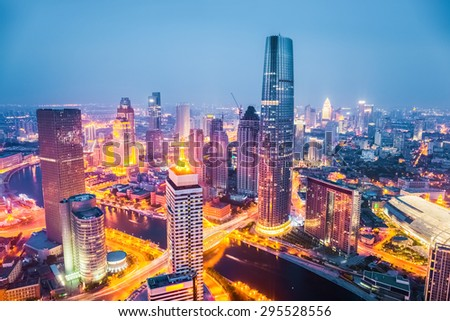 modern city skyline at night in tianjin , streets ablaze with lights - stock photo