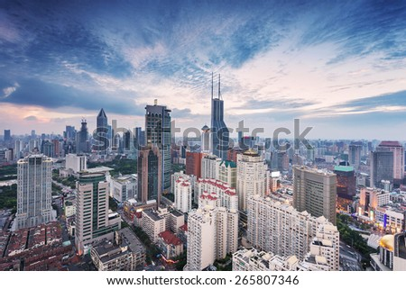 modern city skyline,traffic and cityscape in Shanghai at sunrise - stock photo