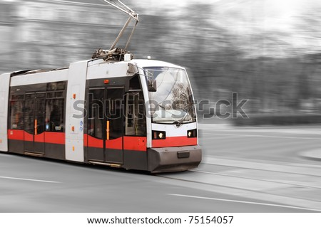 Modern city tram on moving - stock photo