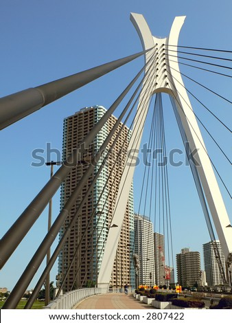 modern city view over suspension bridge support, Tokyo