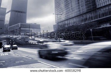 Modern city with busy cars and business buildings and skyscrapers in Hong Kong, China.