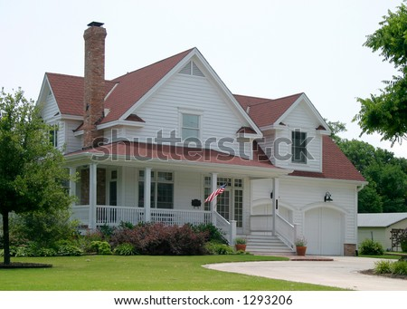 Modern classic new old house design in suburban community flying the US flag out front - stock photo