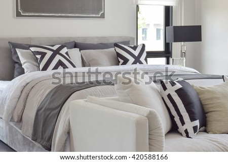 Modern classic style bedding with comfortable sofa in the bedroom - stock photo