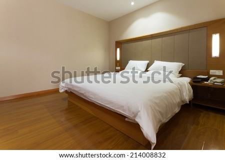 modern clean bedroom with minimalism decoration - stock photo