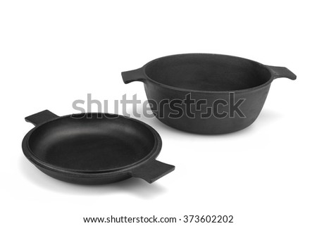 Modern Clean Classic Cast Iron Dutch Oven Or Pot With Pan Cover Isolated On White Background, Close Up, Top View, Horizontal Image, Studio Shot - stock photo
