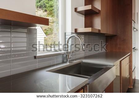 Modern clean kitchen sink - stock photo