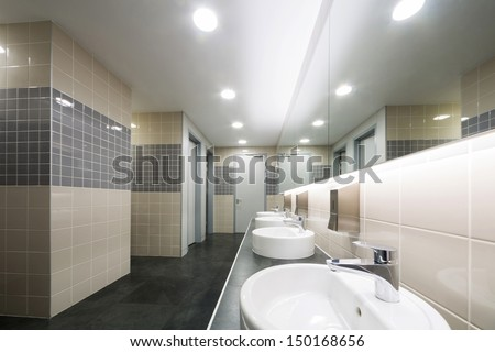 Modern clean toilet decorated with tiles - stock photo