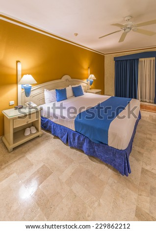 Modern comfortable and elegant master bedroom in a luxury mexican, caribbean  resort hotel. Interior design. - stock photo