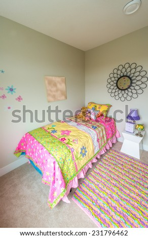 Modern comfortable, nicely decorated bedroom for child with some toys. Interior design. Vertical. - stock photo