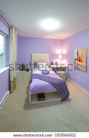 Modern comfortable, nicely decorated children bedroom painted in purple. Interior design. - stock photo