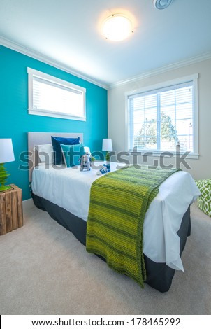 Modern comfortable, nicely decorated children bedroom painted in turquoise. Interior design. - stock photo