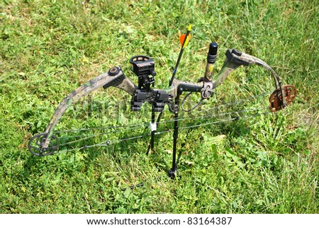 Modern compound bow on green grass