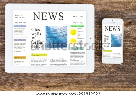 modern computer devices  tablet and phone with news site screen  - stock photo