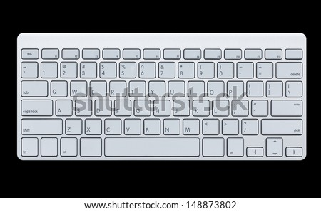 Modern computer keyboard isolated on black background - stock photo