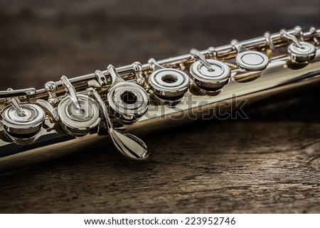 Modern Concert Flute on a Wood Table - stock photo