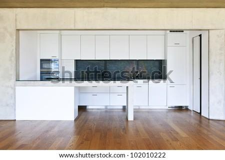 modern concrete house with hardwood floor, kitchen - stock photo