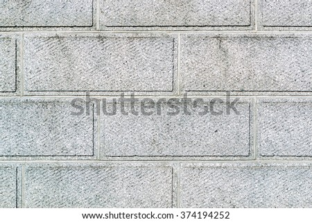 Modern concrete wall texture and brick background. - stock photo