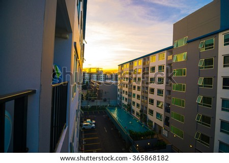 Modern condo residential buildings on afternoon with sun set - stock photo
