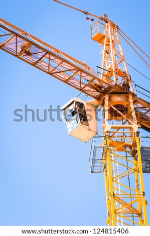 modern construction crane in front of blue sky