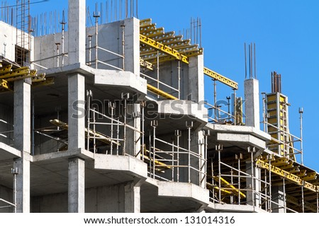 Modern construction site with scaffolding - stock photo