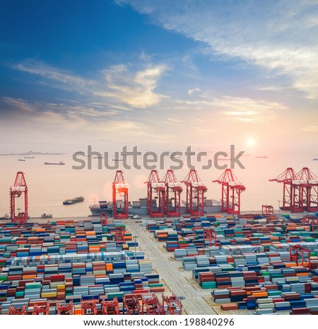 modern container terminal at dusk ,the busy logistics background  - stock photo