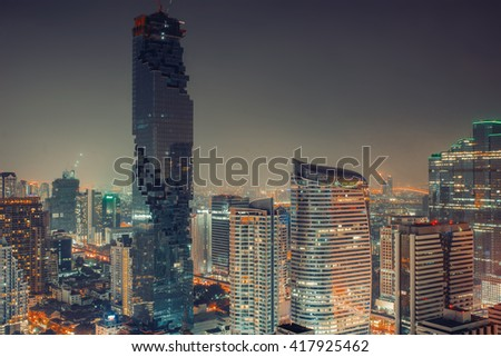 Modern contemporary city night downtown landscape with futuristic architecture. City lights background. Travel inspiration. Urban exploration. Luxury estate sale rent wallpaper. Postcard concept.