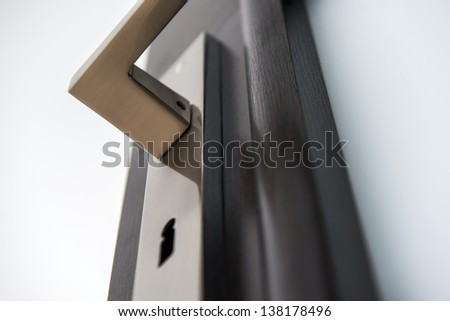 Modern, contemporary handle and keyhole detail - stock photo