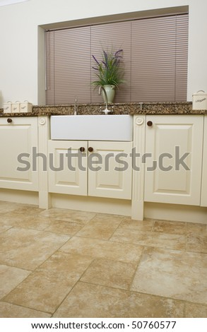 Modern contemporary kitchen interior with granite worktop and cream units focus on the sink area & Modern Contemporary Kitchen Interior Granite Worktop Stock Photo ...
