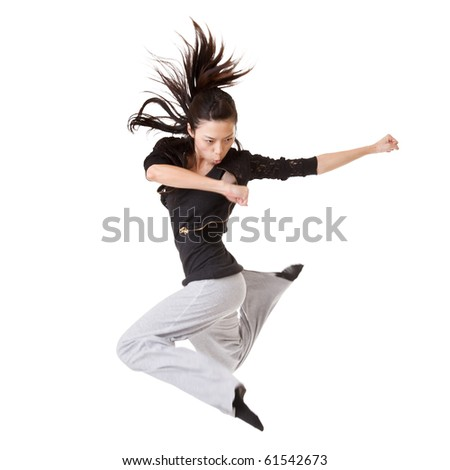 Modern cool woman jumping, isolated on white background. - stock photo