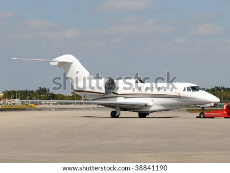 Modern corporate jet used for luxury executive travel - stock photo
