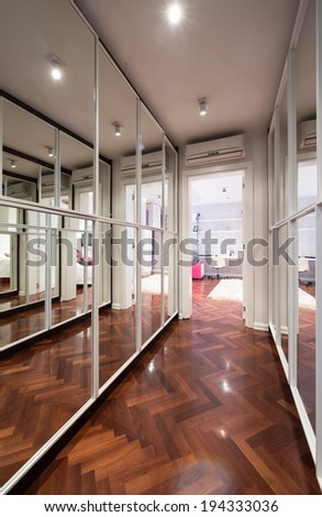 Modern corridor interior with mirror wardrobe doors  - stock photo