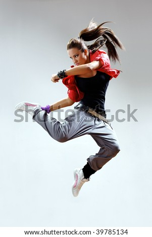 modern dancer poses in front of the gray wall - stock photo
