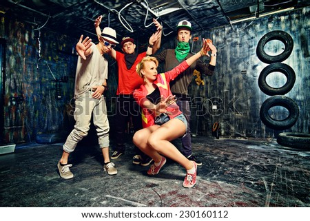 Modern dancers dancing in the garage. Urban lifestyle. Hip-hop generation. - stock photo