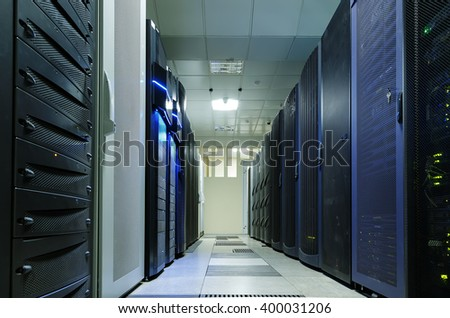 modern data center with rows different communication equipment - stock photo