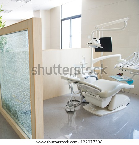 Modern dentistry office interior with chair and tools. - stock photo