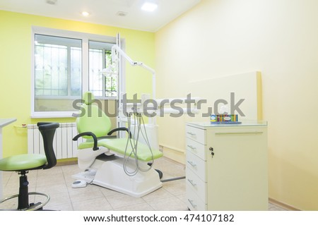 Modern dentistry office interior with chair and tools.