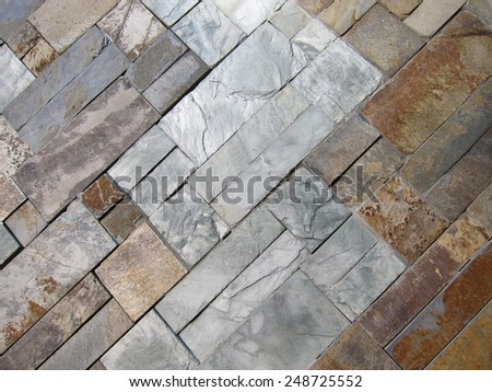 Modern design decorative uneven  stone wall surface - stock photo