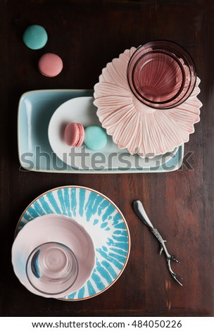 modern design dishes with candies around in pan on a table