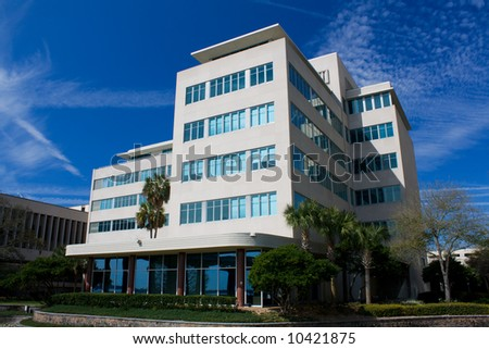 modern design office building with landscaping - stock photo
