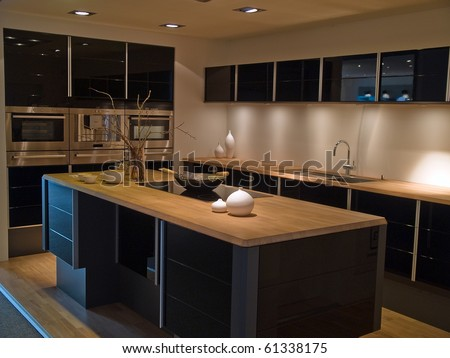 Modern design trendy kitchen with black and wood elements - stock photo