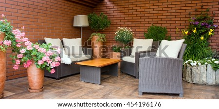 Modern designed outdoor furniture on the terrace - stock photo