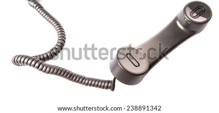 Modern desktop telephone receiver over white background  - stock photo